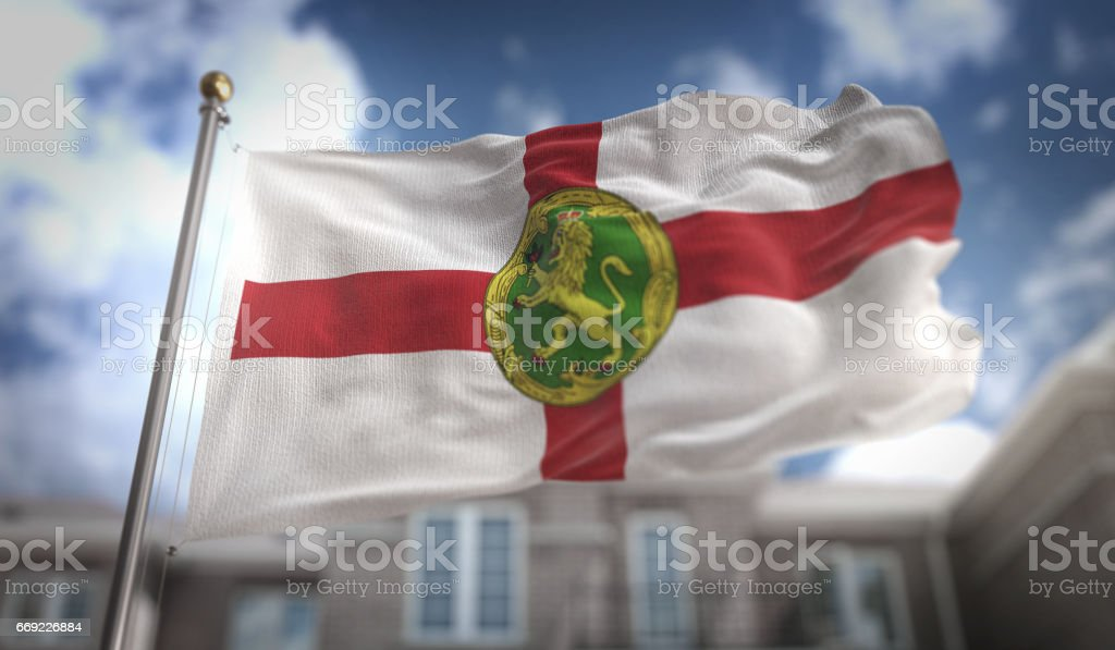 Alderney Flag 3D Rendering on Blue Sky Building Background stock photo