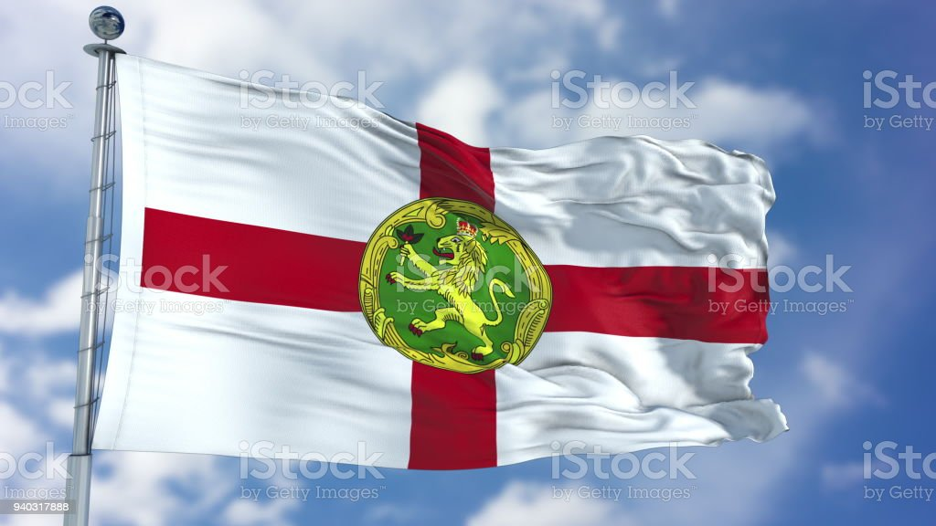 Alderney Flag in a Blue Sky stock photo
