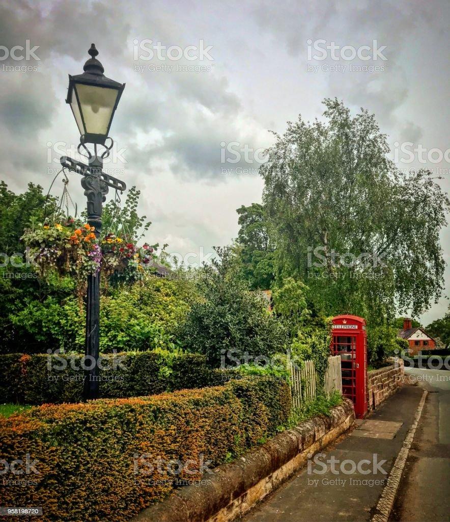 Aldford Village Street lamp and telephone box stock photo