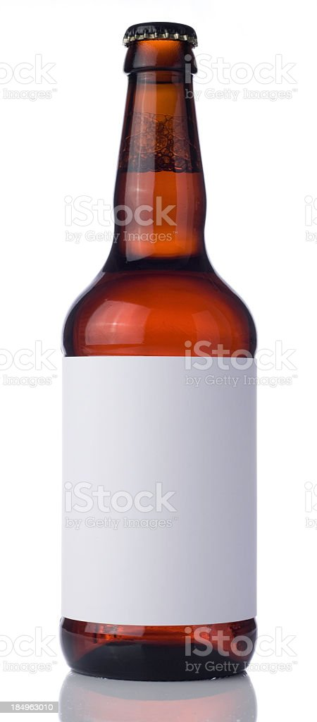 Ale bottle with blank label and bottle cap white background stock photo