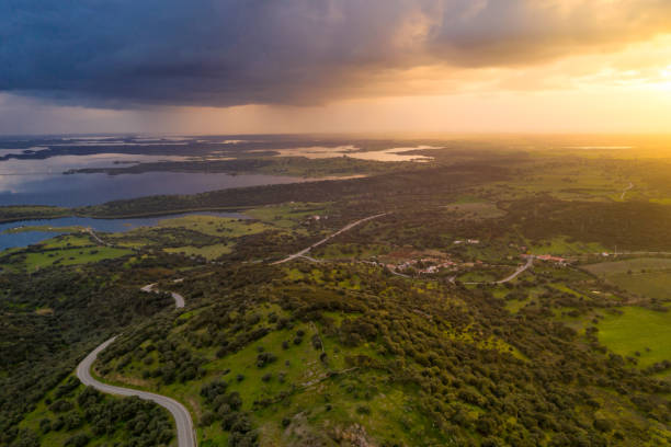 alentejo drone aerial view of the landscape at sunset with alqueva dam reservoir, in portugal - fotos de barragem portugal imagens e fotografias de stock