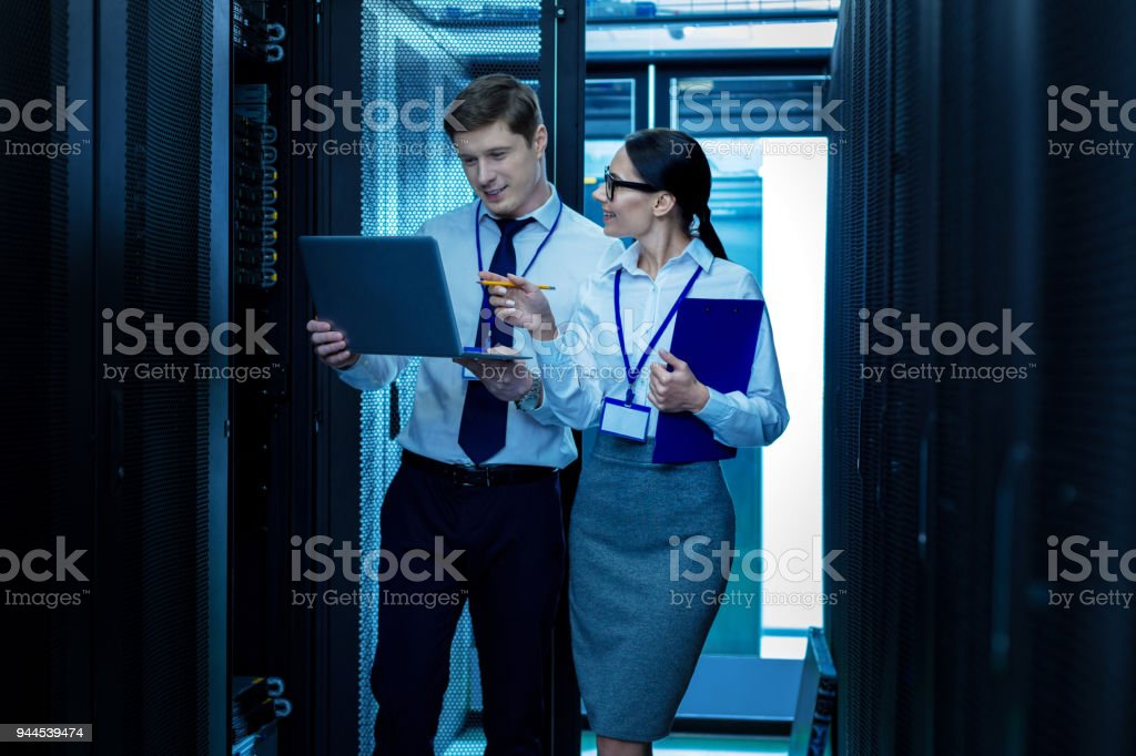 Alert young colleagues discussing work stock photo