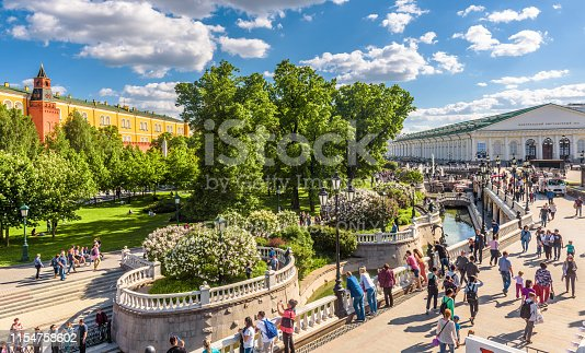 Moscow – May 19, 2019: Alexander Garden and Manezhnaya Square with beautiful fountains in Moscow, Russia. This place is a tourist attraction of Moscow. People walk in the Moscow city center in summer.