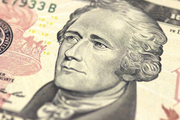 Alexander Hamilton face on US ten or 10 dollars bill macro, united states money closeup. stock photo