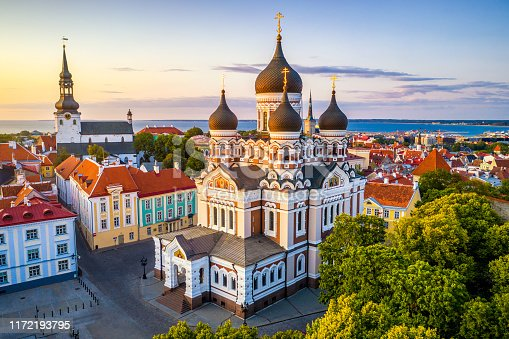 aerial view of Alexander Nevsky cathedral and St Mary's Cathedral at sunset in Tallinn, Estonia