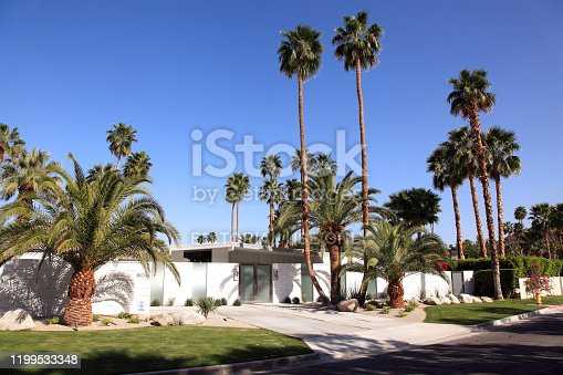 Palm Springs, California, USA- March 23,2013: From the street view of an Alexander type of Mid Century Home.  Built in the mid 1950's Palm Springs. Privacy wall with home hidden behind.