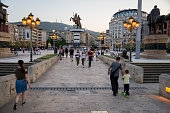 Skopje, Macedonia - April 2018: Alexander the Great statue seeing from old stone bridge