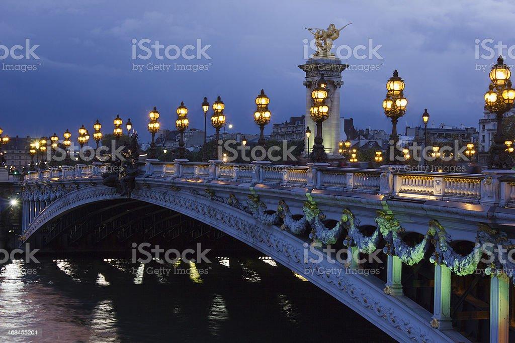 Alexander the Third bridge and Seine at night in Paris - Stock image .