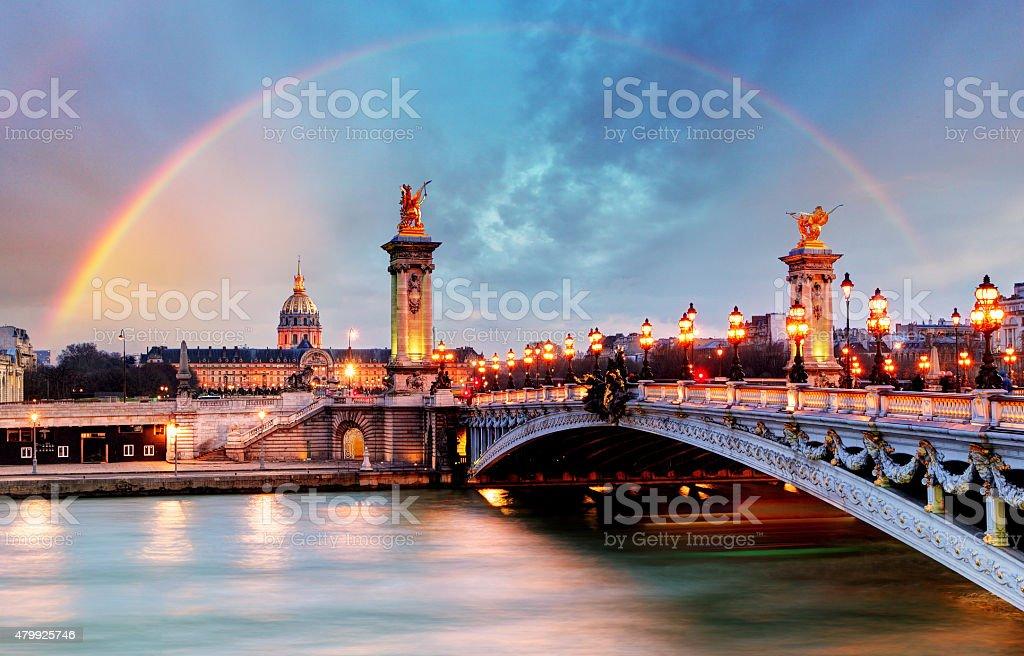 Alexander the Third bridge and Seine at night in Paris stock photo