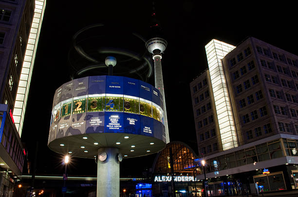 alexanderplatz bei nacht - weltzeituhr stock-fotos und bilder