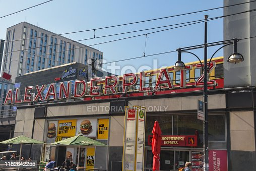 Berlin, Germany, April 15, 2019: Alexanderplatz train station sign.  Alexanderplatz is, according to one study, the most visited area of Berlin, beating Friedrichstrasse and City West. It is a popular starting point for tourists, with many attractions including the Fernsehturm (TV tower), the Nikolai Quarter and the Rotes Rathaus (Red city hall) situated nearby. Alexanderplatz is still one of Berlin's major commercial areas, housing various shopping malls, department stores and other large retail locations.
