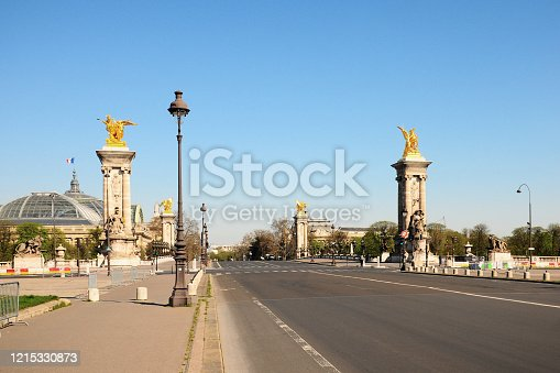 Alexandre III bridge, Esplanade, Quai de Seine and streets are empty during epidemic Coronavirus, in 2020 in Europe. People must be at home and be confine. Stores, restaurant, schools, museums.... are closed. Paris, France. March 25, 2020