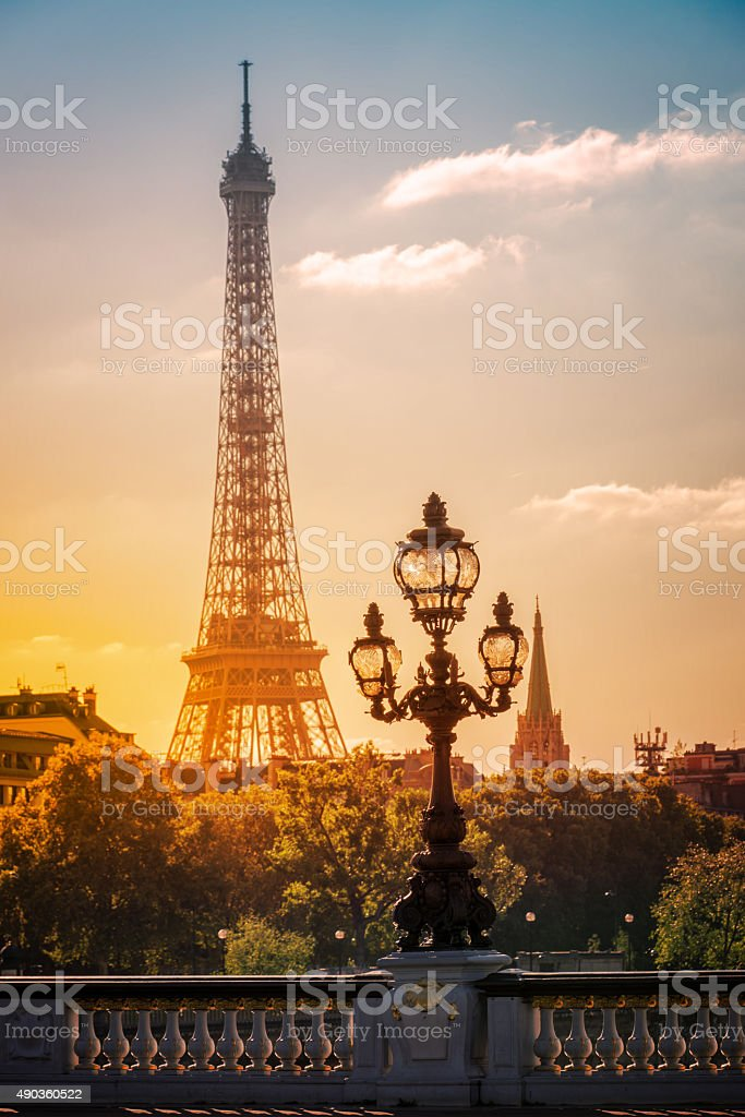 Alexandre III Bridge and Eiffel Tower in Paris, France stock photo