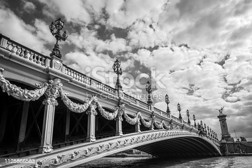 Alexandre III bridge and the river Seine in Paris France, black and white photography