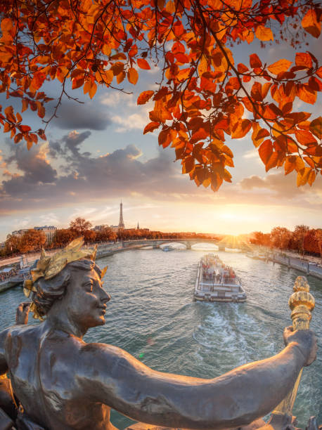 Alexandre III bridge in Paris against Eiffel Tower with autumn leaves, France stock photo