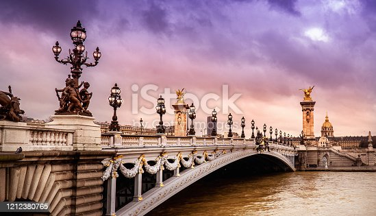 Paris Pont Alexandre III and Les Invalides at the sunset. Horizontal composition.