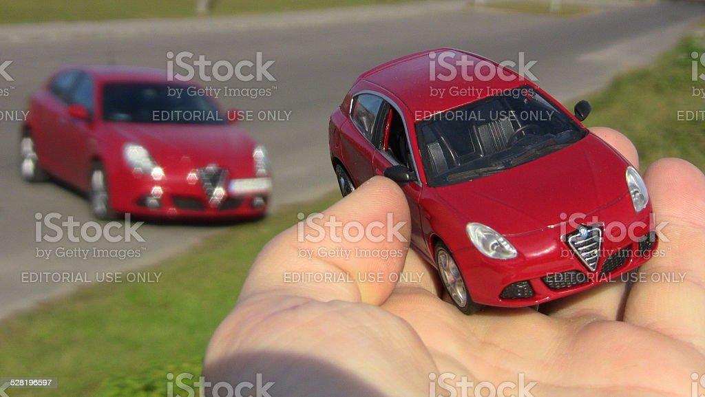 Alfa Romeo model in scale on the hand stock photo