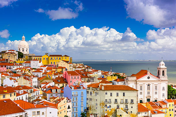 alfama lisbon cityscape - portugal stock photos and pictures