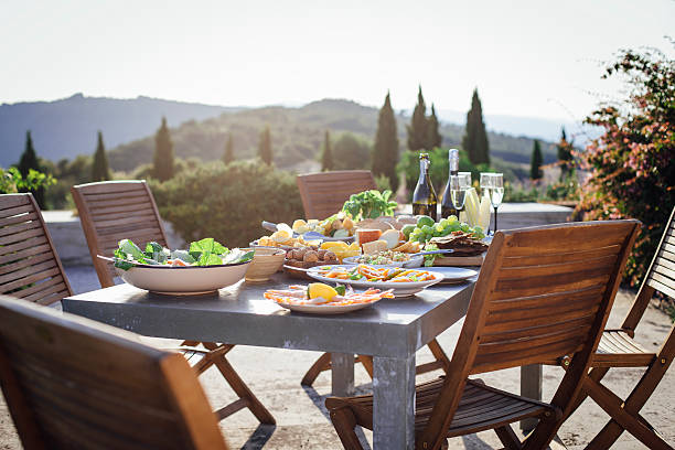 alfesco mediterranean meal - mediterranean culture stock photos and pictures
