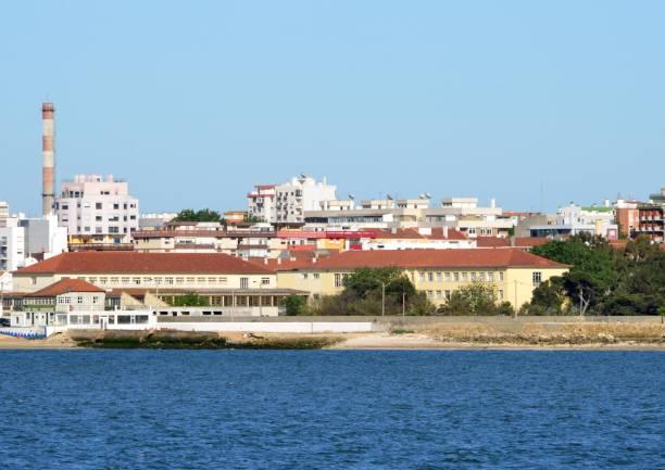 alfredo da silva highschool and the tagus river, barreiro, portugal: - setubal imagens e fotografias de stock
