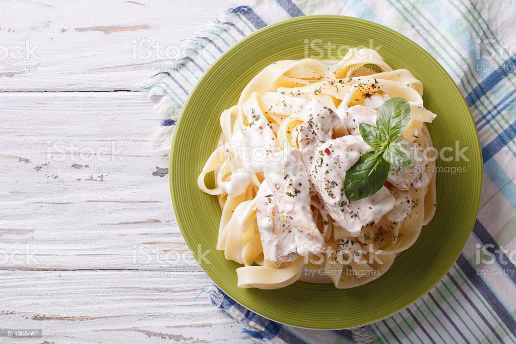 alfredo pasta in cream sauce with chicken. horizontal  top view stock photo