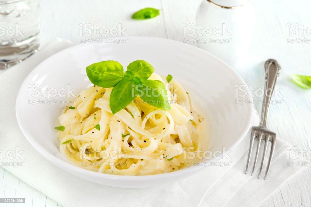 Alfredo tagliatelle pasta stock photo