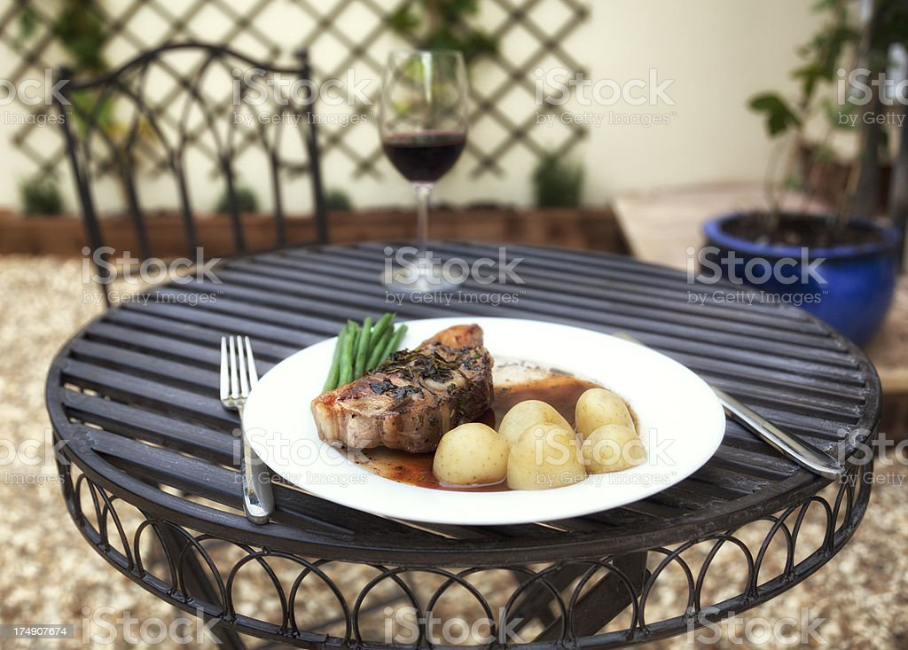 Alfresco dining: Lamb in red wine  jus royalty-free stock photo