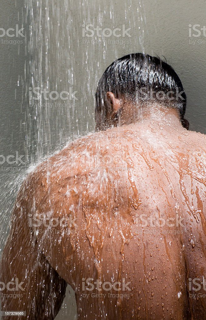 alfresco showering male nude stock photo