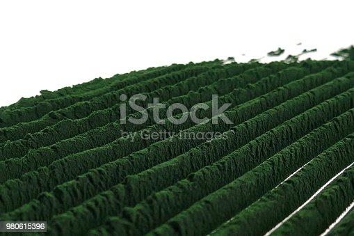 istock Algae spirulina on a white background.green spirulina powder background.Spirulina powder close-up.Super food . Food supplements for a healthy lifestyle 980615396