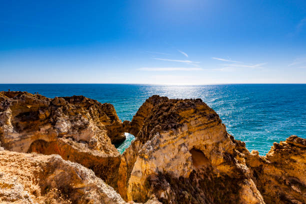 algarve coastline in portugal - rocky coastline stock pictures, royalty-free photos & images