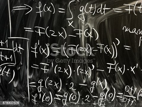 istock Algebra and mathematics equations written in chalk on school blackboard 878302526