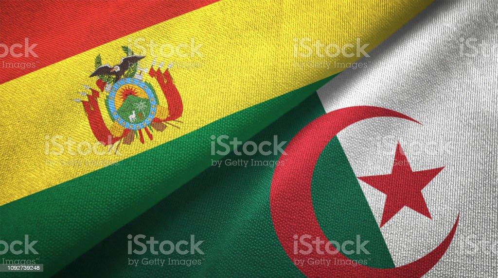 Argelia y Bolivia dos banderas juntos relaciones textil tela textura de la tela - foto de stock