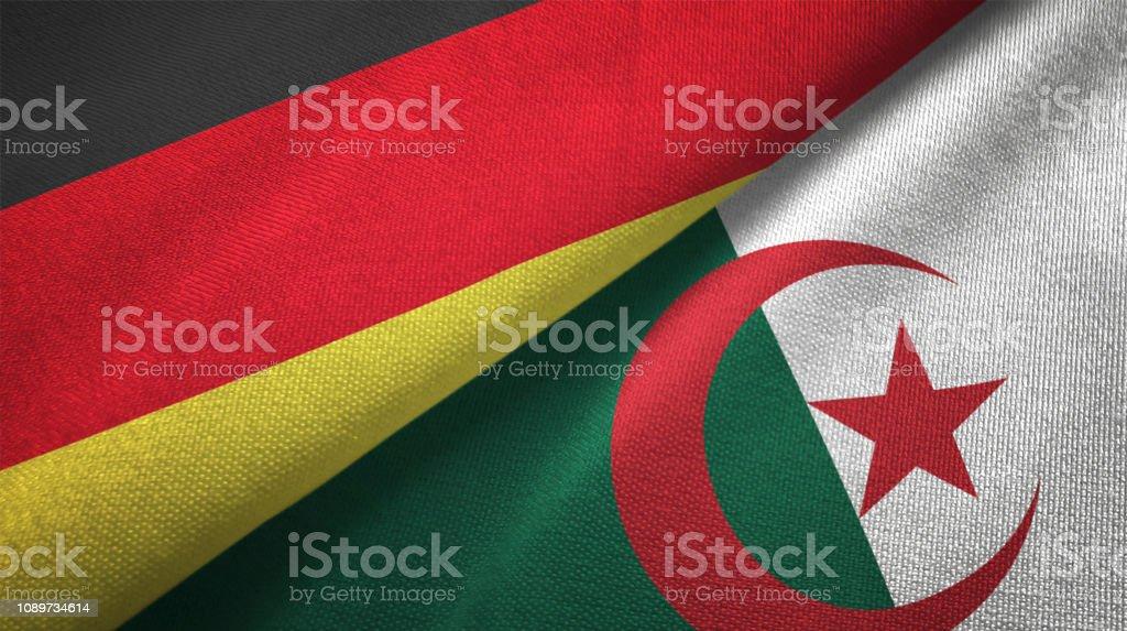 Argelia y Alemania dos banderas juntos relaciones textil tela textura de la tela - foto de stock