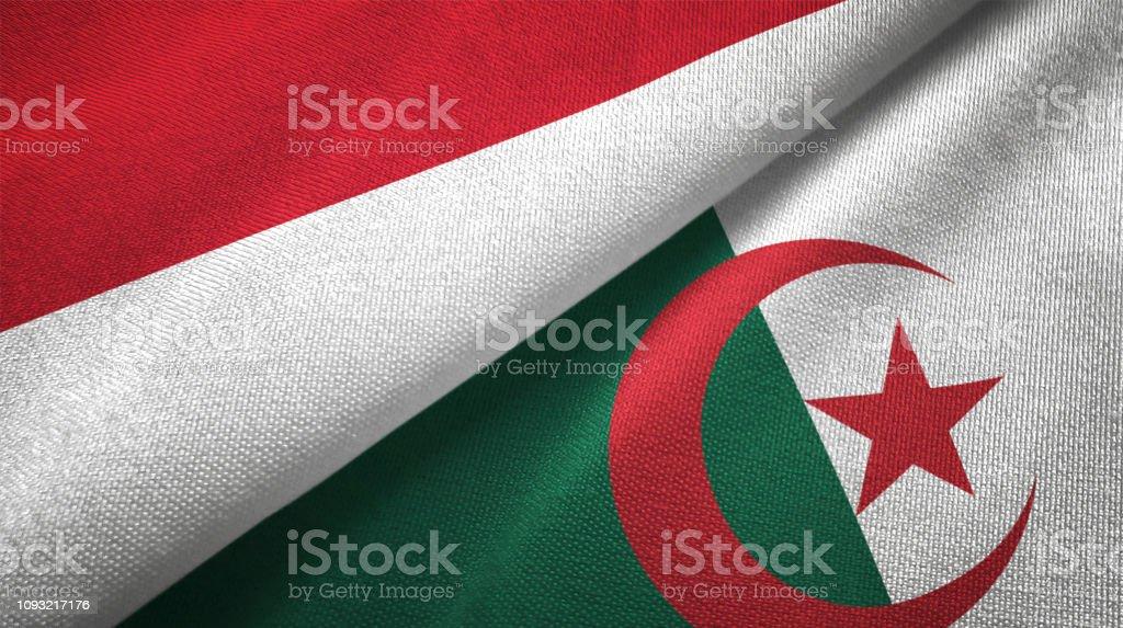 Argelia e Indonesia dos banderas juntas textil tela textura de la tela - foto de stock