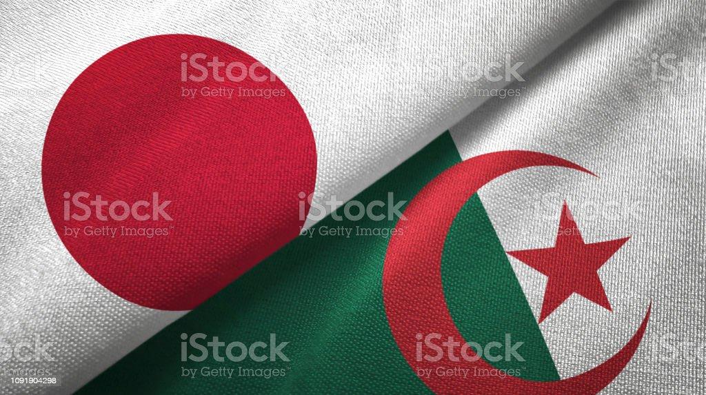Argelia y Japón dos banderas juntos relaciones textil tela textura de la tela - foto de stock