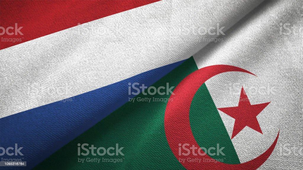 Argelia y países bajos dos banderas juntas textil tela textura de la tela - foto de stock