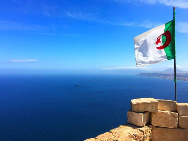 algerian flag at fort santa cruz, oran (wahran) - algeria stock photos and pictures