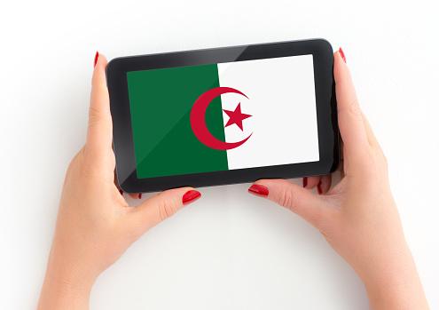 algerian Flag on tablet in female hands