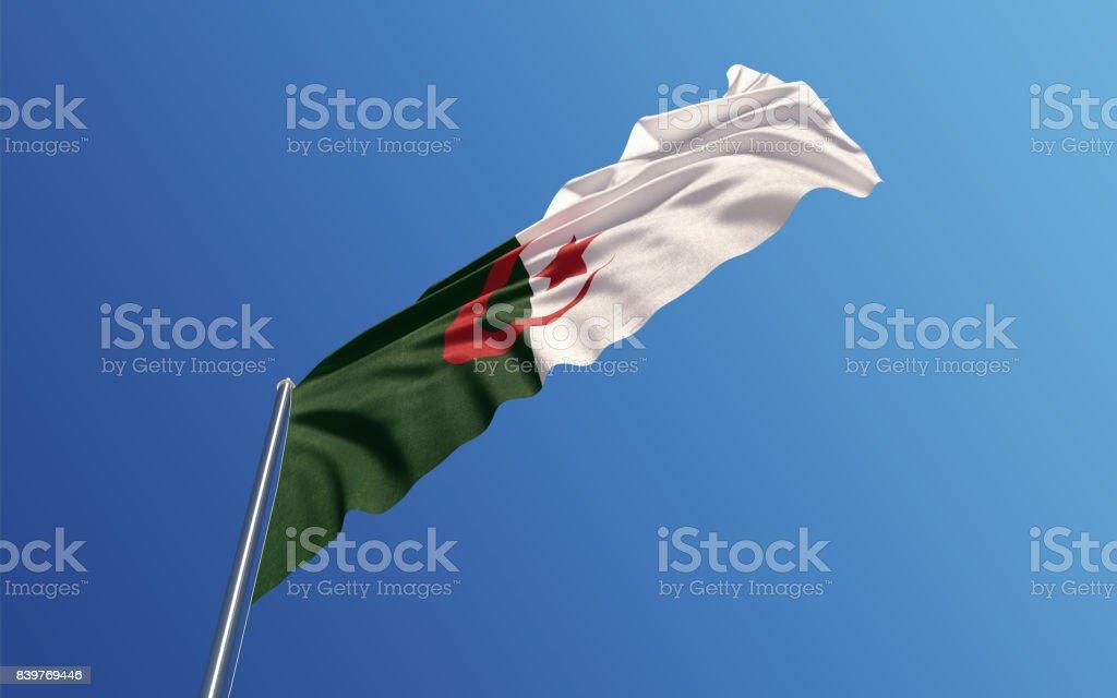 Argelia bandera ondeando con el viento en el cielo azul - foto de stock