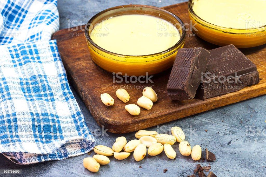 algerian sweet food caramel flan with peanuts and chocolate bars - Royalty-free Algeria Stock Photo