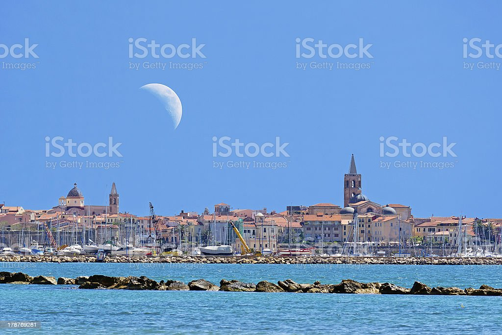 Alghero and moon stock photo