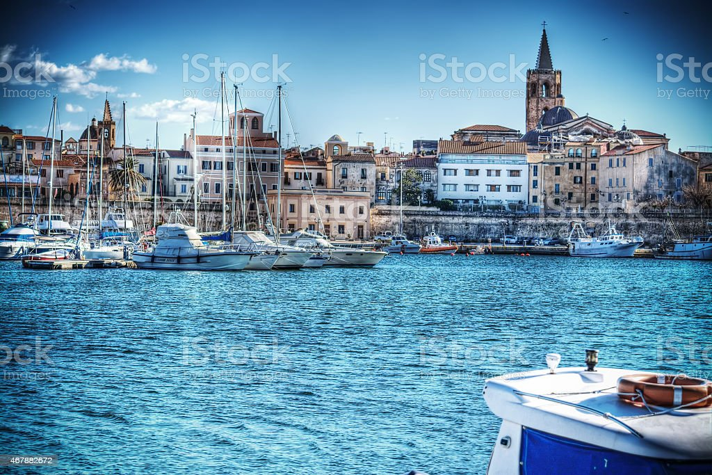 Alghero harbor on a clear spring day in hdr stock photo