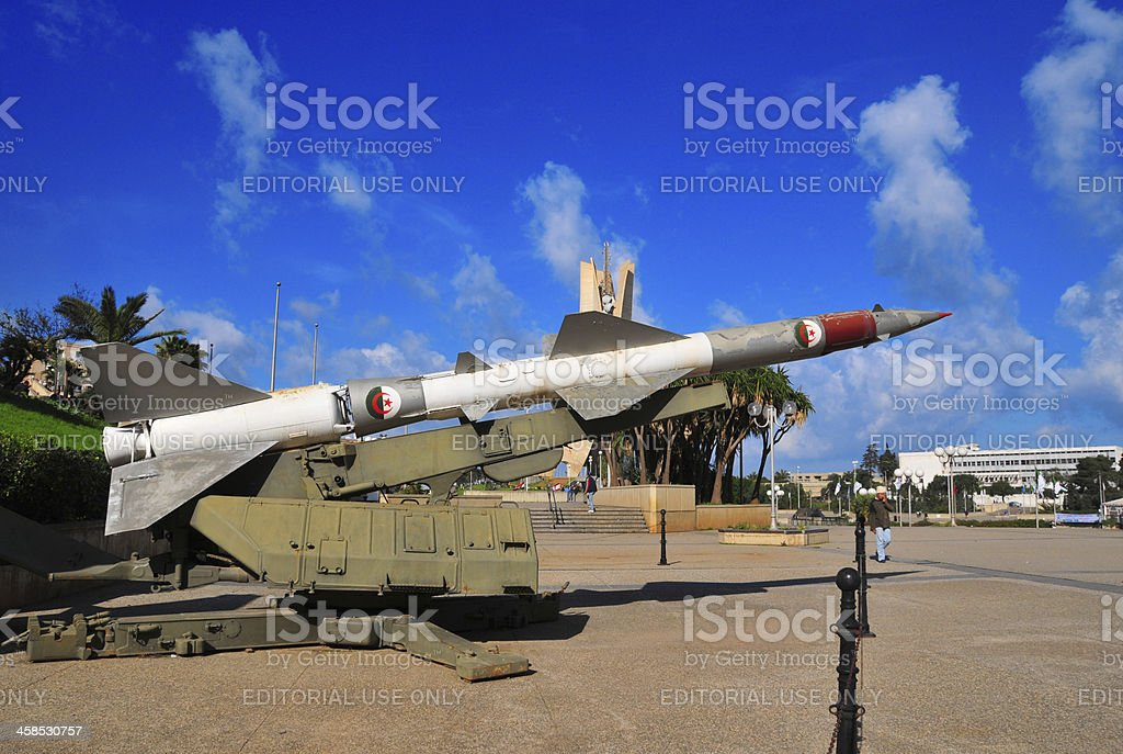 Algiers, Algeria: pedestrian passing by a SAM-2 missile stock photo