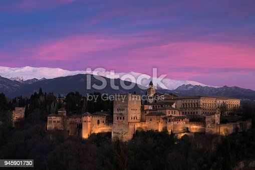 Alhambra at sunset with Sierra nevada in the background.