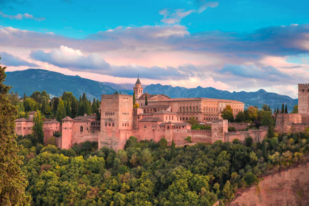Alhambra at sunset in Granada, Andalusia, Spain Palace and fortress complex Alhambra with Comares Tower, Palacios Nazaries and Palace of Charles V during sunset in Granada, Andalusia, Spain palacios nazaries stock pictures, royalty-free photos & images