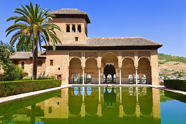 Alhambra de Granada. El Partal A large central pond faces the arched portico behind which stands the Tower of the Ladies palacios nazaries stock pictures, royalty-free photos & images