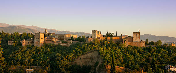 Alhambra Golden Hour Panorama in Granada, Spain This photograph was taken at twilight from San Nicolas church in Albaicin. palacios nazaries stock pictures, royalty-free photos & images