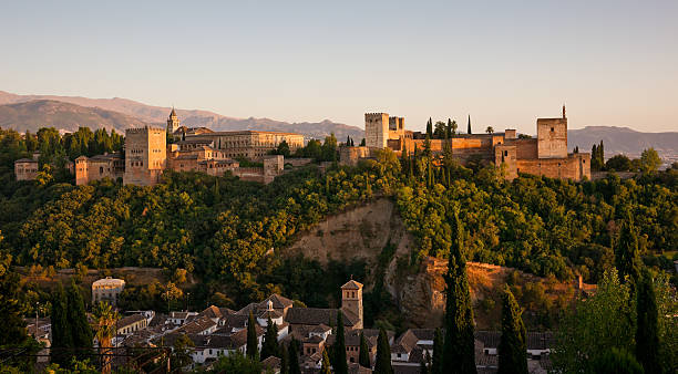 Alhambra Golden Hour Panorama in Granada, Spain This photograph was taken at twilight from San Nicolas church in Albaicin. palace of charles v stock pictures, royalty-free photos & images