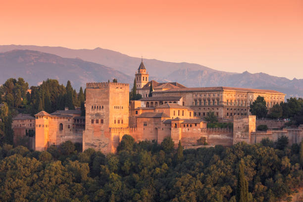 Alhambra, Granada View of Alhambra in the evening, in front the Nasrid Palaces and behind it the Palace of Charles V. palace of charles v stock pictures, royalty-free photos & images