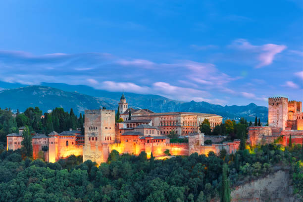 Alhambra in the evening in Granada, Andalusia, Spain Alhambra during evening blue hour in Granada, Andalusia, Spain iberian stock pictures, royalty-free photos & images